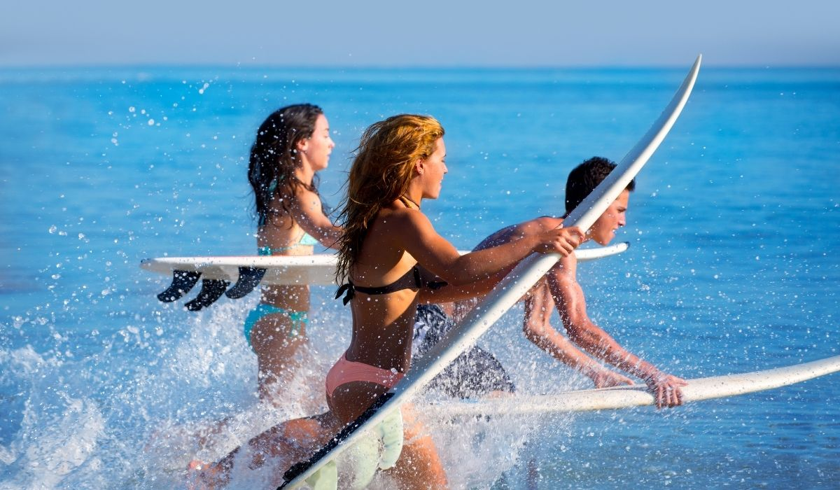 Three-surfers-about-to-put-their-boards-into-the-water