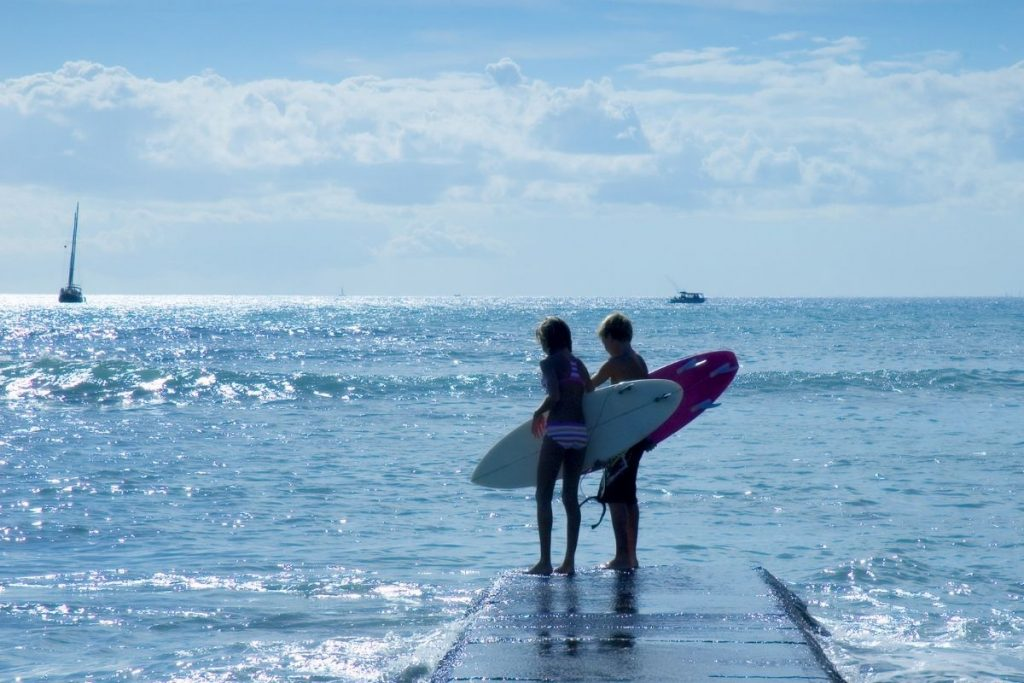 young kids with their surfboards
