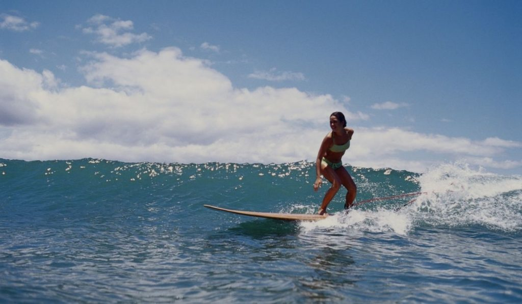 female surfing