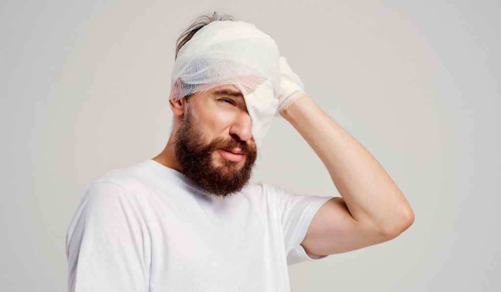 man with head and eye injury