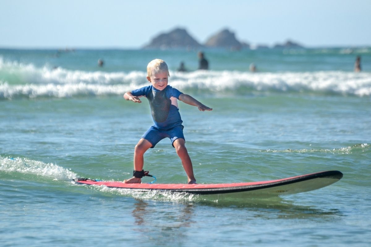 small child riding a surfboard