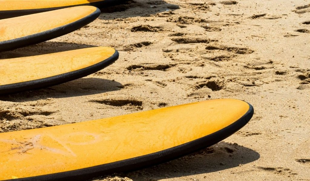 yellow surfboards on the beach