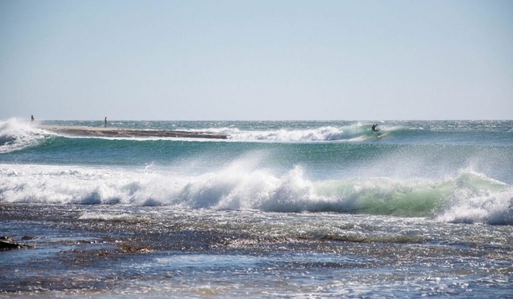 a surfer at a point break wave